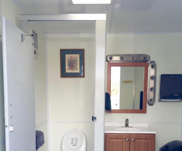 Medium Restroom Trailer Rentals DE - male inside 1